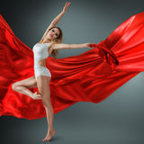 Woman dancing with flying fabric Royalty Free Stock Photo