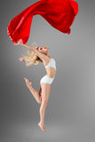 Woman dancing with flying fabric Stock Image