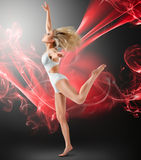 Woman dancing with flying fabric Royalty Free Stock Images