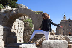 Woman dancing in front of an arch Stock Image