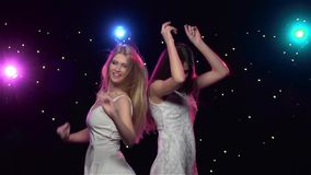 Woman dancing in front of disco style lights. Slow motion stock video footage