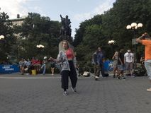 Woman dancing in front of George Washington Statue in Union Squa Stock Photo