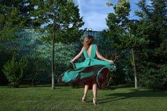 Woman dancing in the garden Stock Image