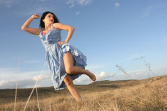 Woman dancing on the grass Stock Photography