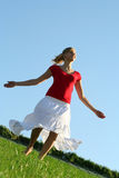 Woman dancing on grass. Young woman dancing on grass Royalty Free Stock Images