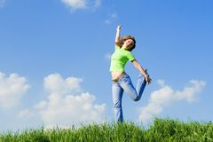 Woman dancing on green grass Stock Photos
