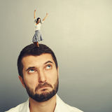 Woman dancing on the head of man. Excited young women dancing on the head of man Stock Photos