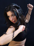 Woman dancing with headphones Stock Photos