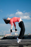 Woman dancing hip hop. Beautiful woman dancing hip-hop modern style over urban city landscape and blue sky Stock Images
