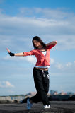 Woman dancing hip hop over blue sky Royalty Free Stock Images