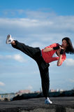 Woman dancing hip hop over blue sky Stock Photography