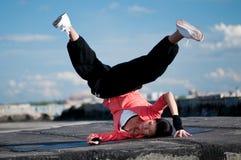 Woman dancing hip hop over blue sky Stock Image