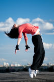 Woman dancing hip hop over blue sky Stock Images