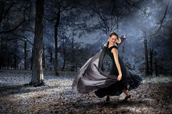 Woman Dancing In The Forest Royalty Free Stock Image