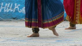 Woman dancing indian dance with bells on her legs