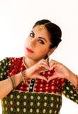 Woman dancing Indian dance in national dress. Shree kurta. Woman dancing Indian dance in national dress. A beautiful girl portrait in shree kurta patiala set Stock Images