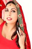 Woman dancing Indian dance in national dress. A handsome beautiful girl portrait in red Hindu Saree, horn for the Indian dance movement. Indian dancer in Stock Photography