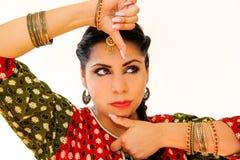 Woman dancing Indian dance in national dress. Shree kurta. Woman dancing Indian dance in national dress. A beautiful girl portrait in shree kurta patiala set Royalty Free Stock Photo