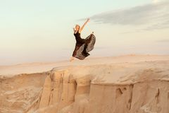 Woman while dancing jumped into the abyss. Royalty Free Stock Photography