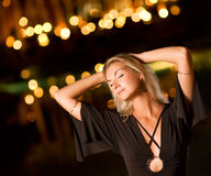 Woman dancing late at night Stock Images