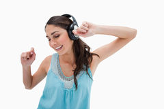Woman dancing while listening to music Stock Photography