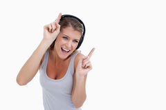 Woman dancing while listening to music Royalty Free Stock Images