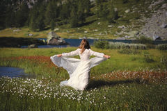 Woman dancing with mountain wind. Woman with vintage dress dances with the mountain winds Stock Image