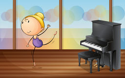 A woman dancing near the piano Royalty Free Stock Photos