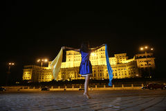 Woman dancing in the night city view Stock Photos