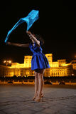 Woman dancing in the night city view Stock Photo