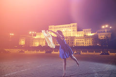 Woman dancing in the night city view Stock Photography