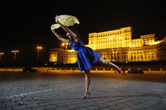 Woman dancing in the night city view Stock Image