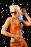 Woman dancing in the nightclub Stock Photos