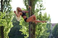 Woman Dancing on Pole Stock Photos