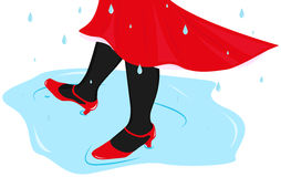 Woman dancing in a puddle Royalty Free Stock Photo