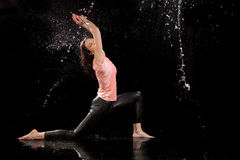 Woman dancing rain black background royalty free stock image