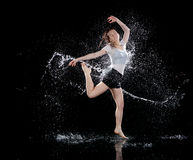 Woman dancing rain black background stock photography