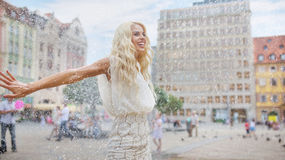 Woman dancing in the rain Royalty Free Stock Photography