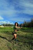 Woman dancing at the rainbow gathering. stock images