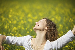 Woman dancing in rapeseed field Stock Image