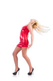 Woman dancing in red dress isolated Stock Image