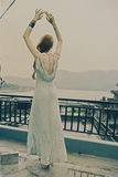 Woman dancing on the roof Royalty Free Stock Image