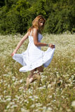 Woman Dancing In Savage Garden Stock Photography