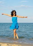 Woman dancing in the sea Stock Photo