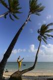 Woman dancing beside the seashore stock image
