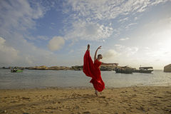 Woman dancing beside the seashore royalty free stock image