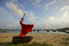Woman dancing beside the seashore Royalty Free Stock Images