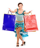 Woman dancing with shopping bags. Stock Photo