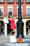 Woman dancing after shopping in spain Royalty Free Stock Photo