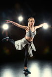 Woman dancing in sportive clothing Royalty Free Stock Image
